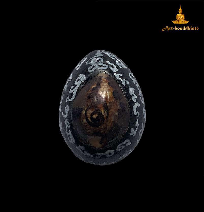 talisman bouddhiste coquillage